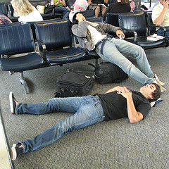 People asleep in airport waiting areas