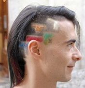 Shaved head with Tetris blocks painted in